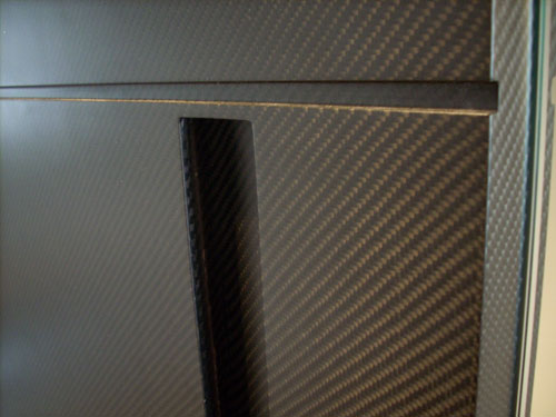 Carbon fiber door handle area