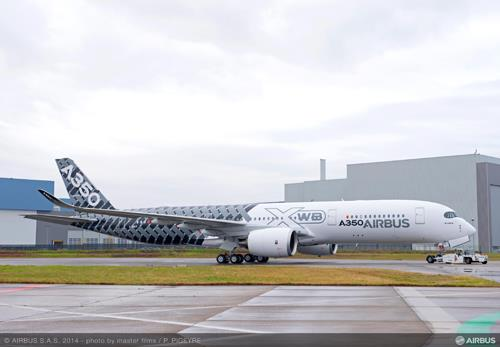 Airbus rolls out third A350 XWB test plane with carbon fiber livery