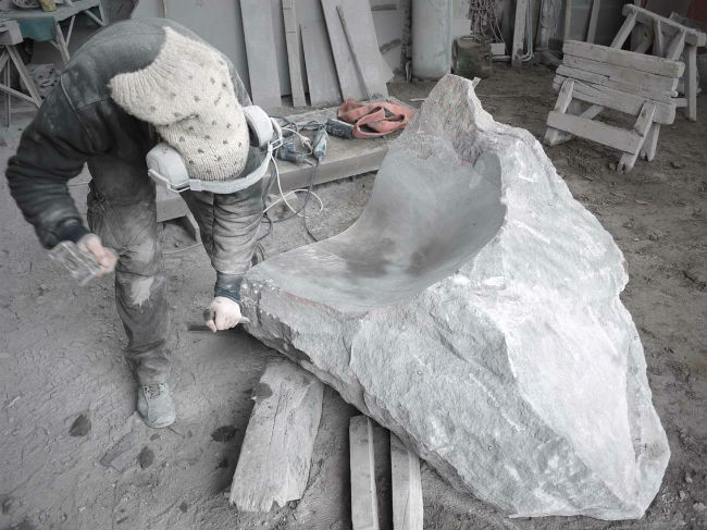 Volcanic stone being shaped
