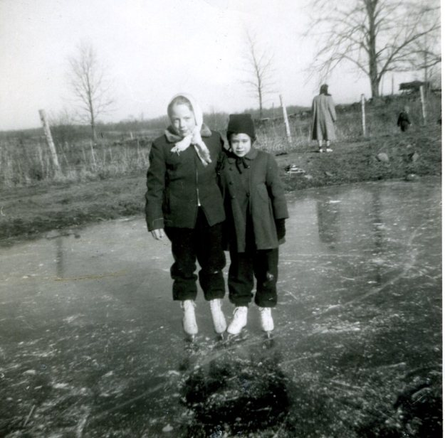 Cousin Nancy and Carol skating on the cow pond, 1953