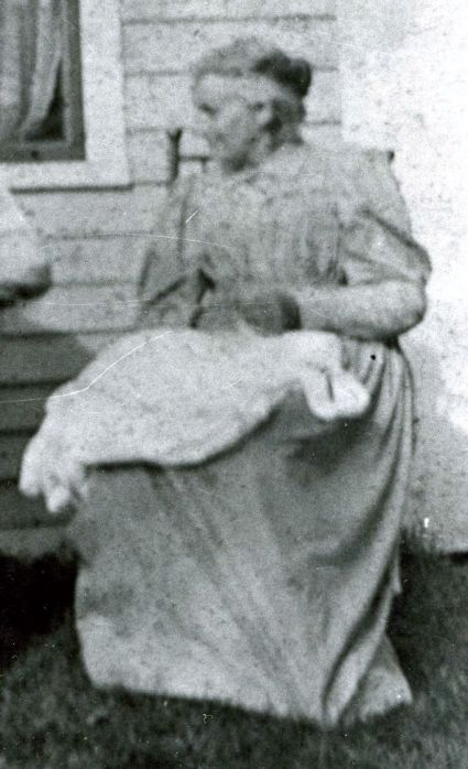 "Lydia Jane Hall with ""make-work"" on her lap, around 1900"
