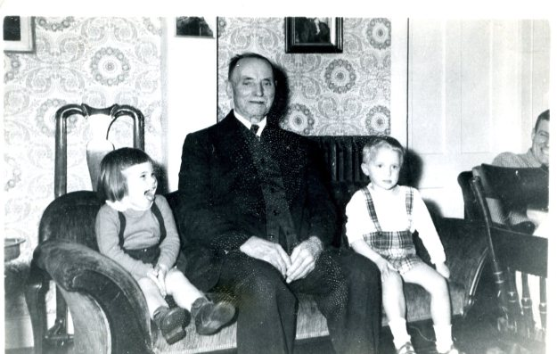 Living room in 1949 - Carol Crump, Great-grandpa Biggs, Tuck Norton, John Norton