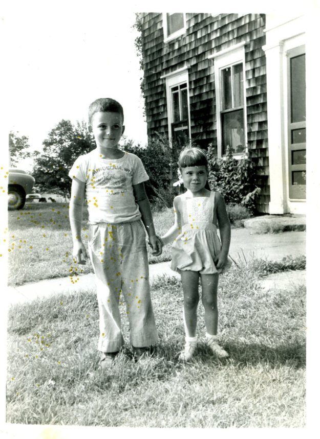 Tom Teter and Carol Crump in front of the farmhouse on Whirlwind Hill, 1949