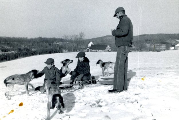 Chris Heilman, Kirt Crump, and Francis Hall on Whirlwind Hill with coon dogs.