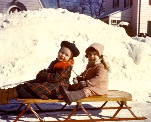 Sue Collins and Carol Crump on a Radio Flyer.