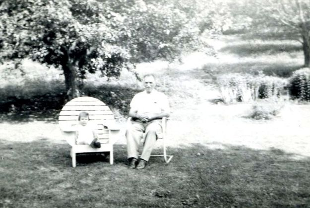 Me and my Great-Grampa Biggs sitting in the yard on a summer day, 1947