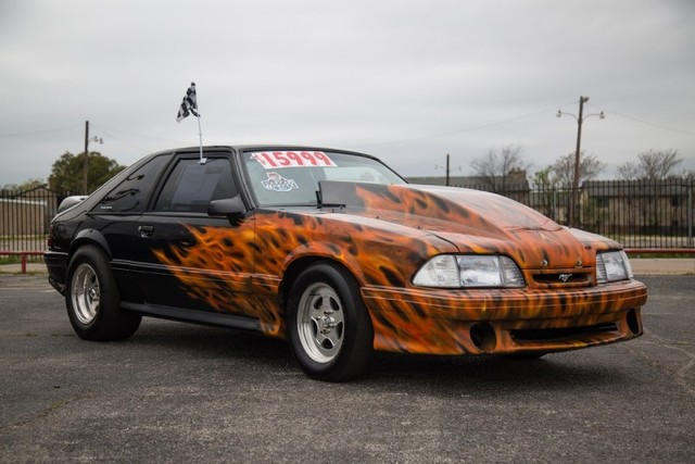A Ford Mustang with fire paint