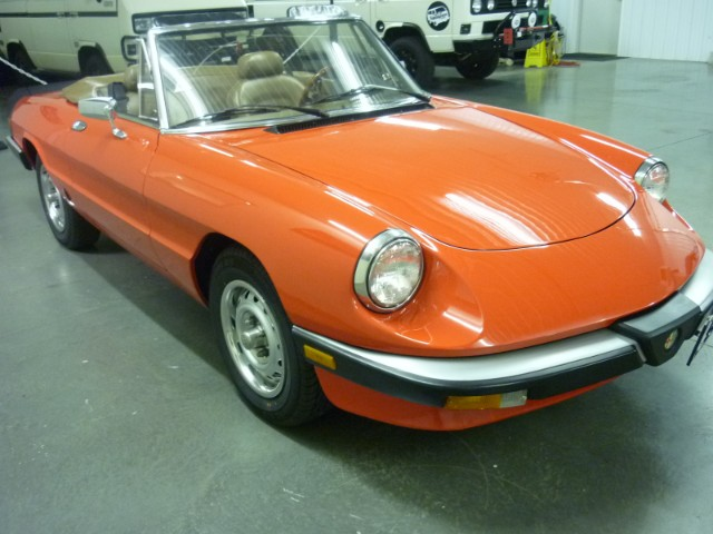 An orange Alfa Romeo Spider