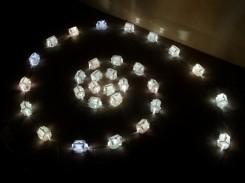 Houses of the rising sun, 2005. Una spirale di casette illuminate.