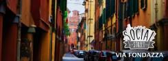 """Una foto di Via Fondazza con il logo """"social street"""" - foto Francesca Bastiani, logo Laura Ninfa"""