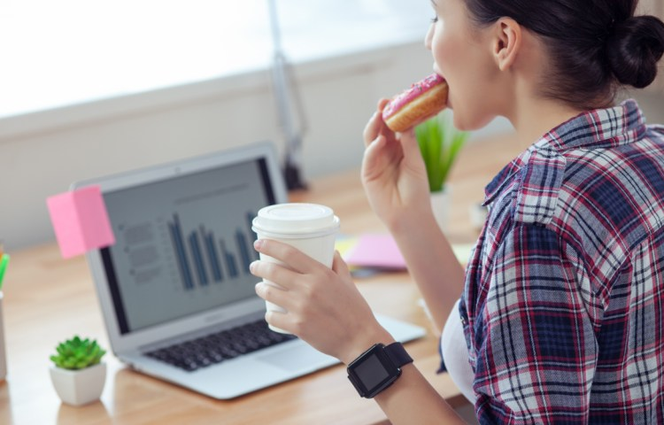 female worker is snacking in office