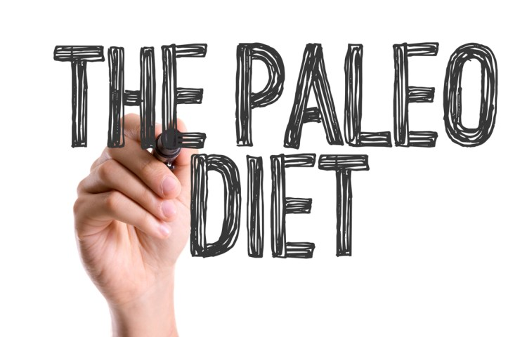 Hand with marker writing the word The Paleo Diet