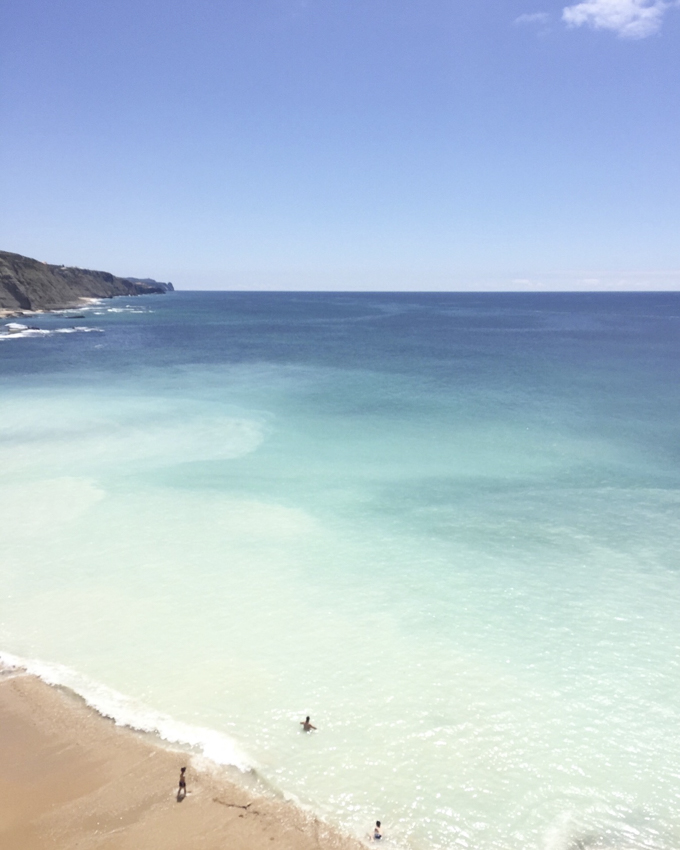 Turquoise water at Praia do Magoito by Cattie Coyle Photography