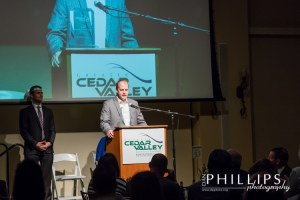 CEO Mike Mallaro accepts the Business of the Year Award.