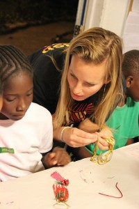 LREP Manager Dr. Jocelyn Curtis-Quick helps students plan the construction of holiday ornaments out of lionfish fins.