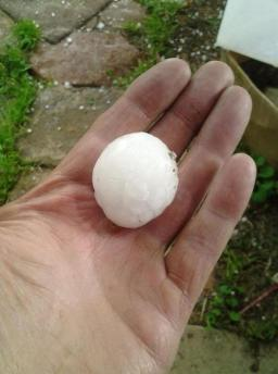 large hailstone in palm of hand