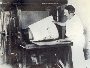 Louis Icart pulling a proof of Joy of Life from the etching press