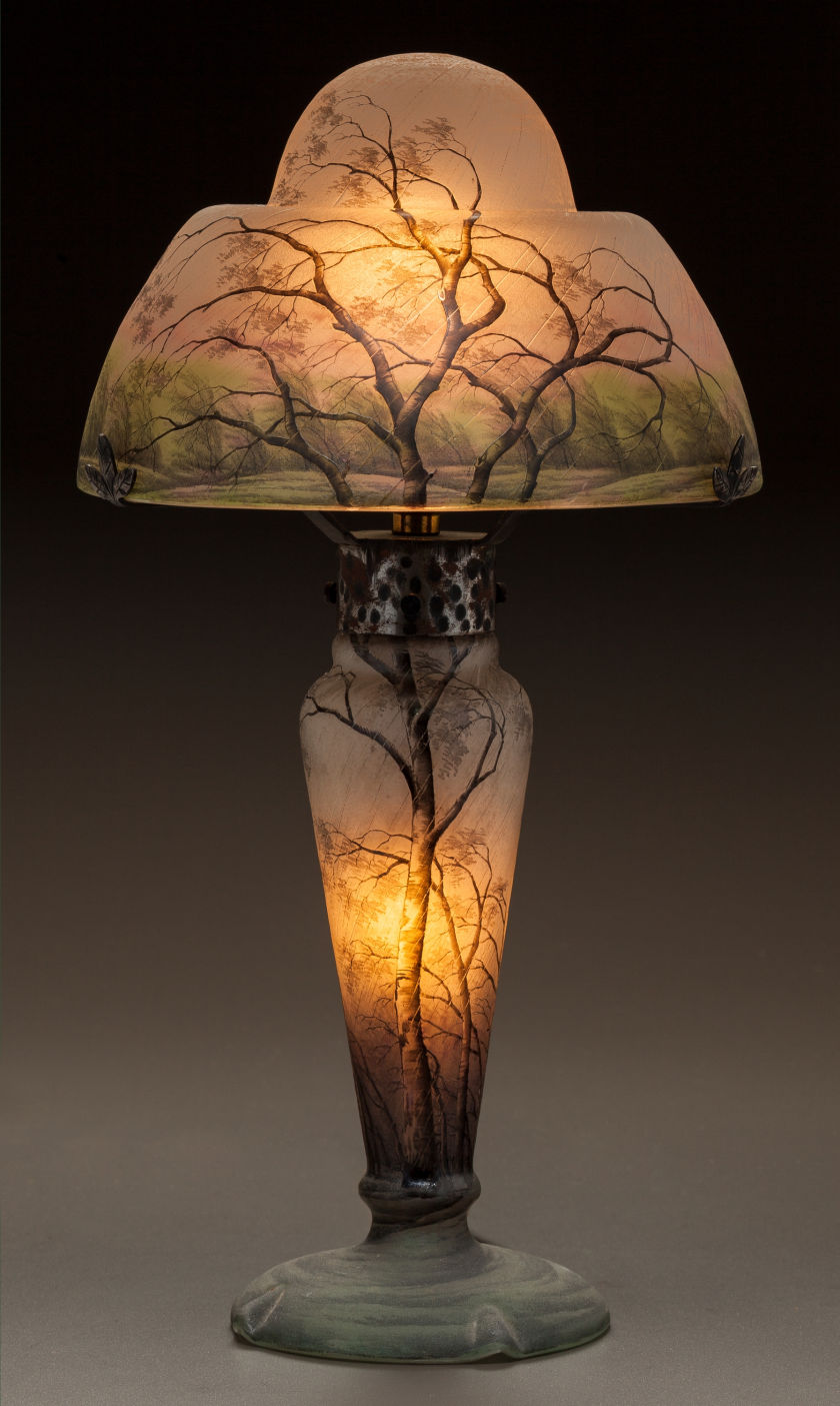 A Tiffany Studios Border Peony floor lamp led the way at