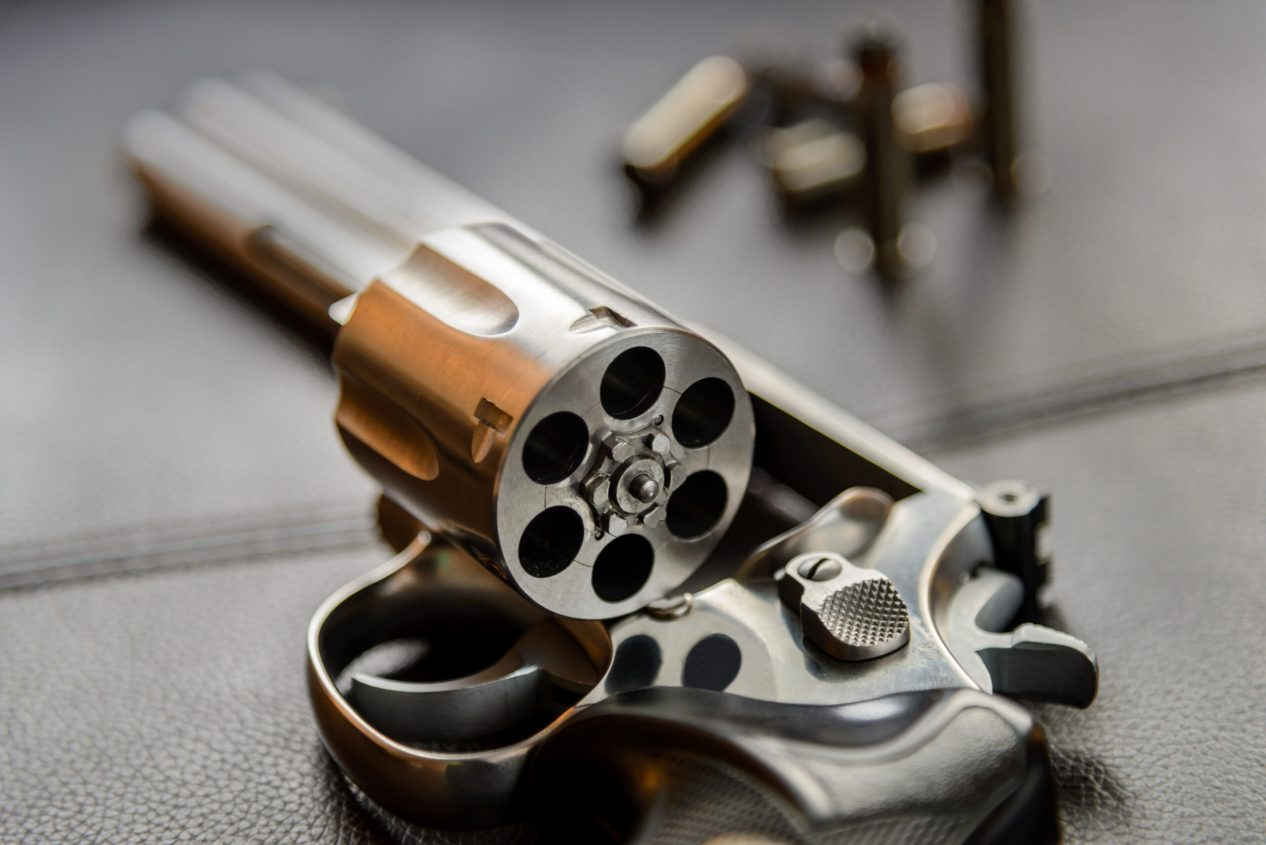 .357 Caliber Revolver Pistol, Revolver open ready to put bullets on leather furniture