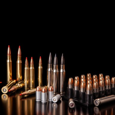 Different Rifle Calibers Defensive Ammunition on Table with Black Background