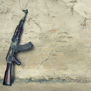old kalashnikov AK-47 against the wall