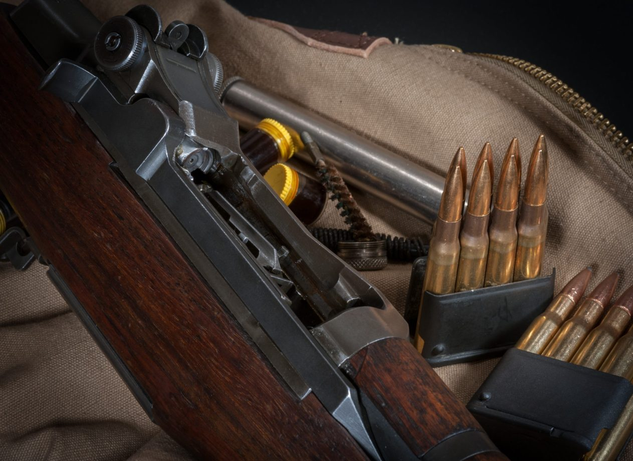 American WWII battle rifle M1 with 30-06 ammunition in en bloc clips with grease pots and nickel oiler tube