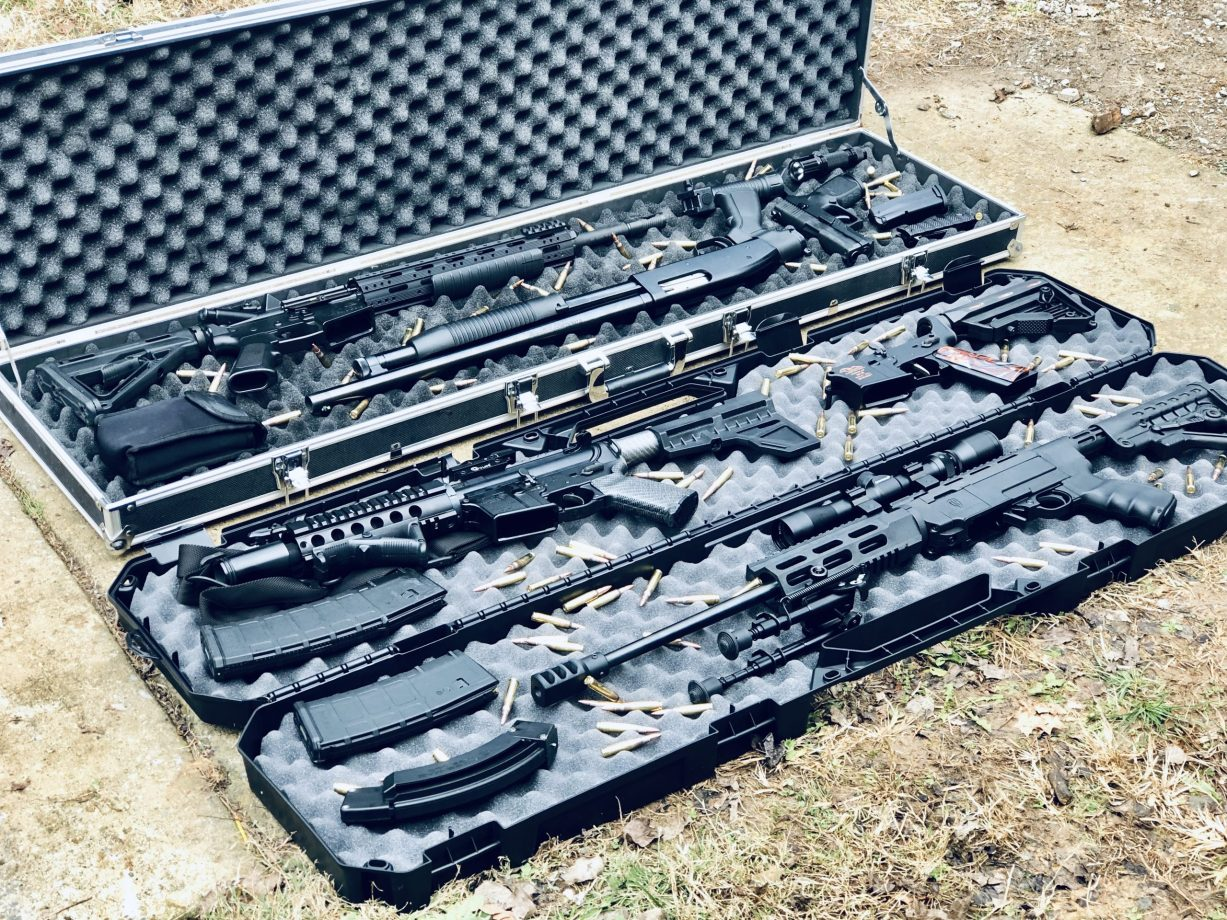 Several rifles in hard cases