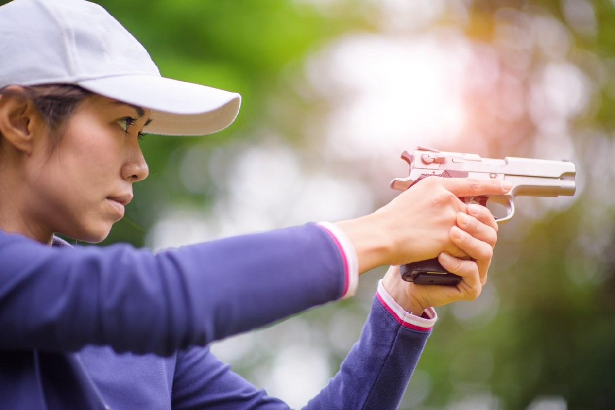 Woman shooting handgun