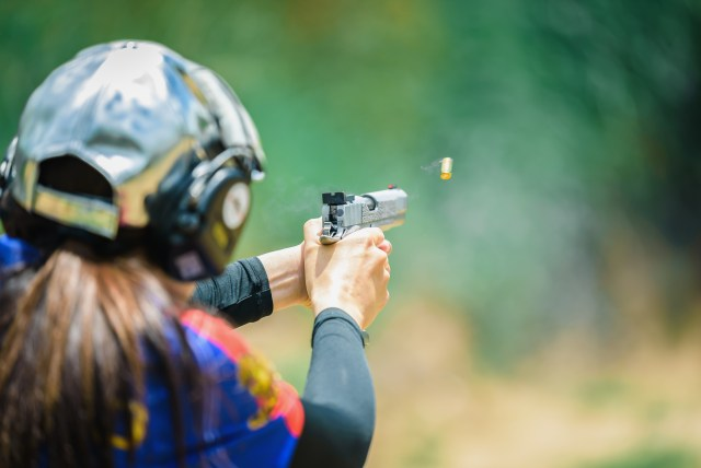 Female competition shooter shooting handgun