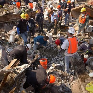 Picture shows volunteers at Ground Zero picking up debris.