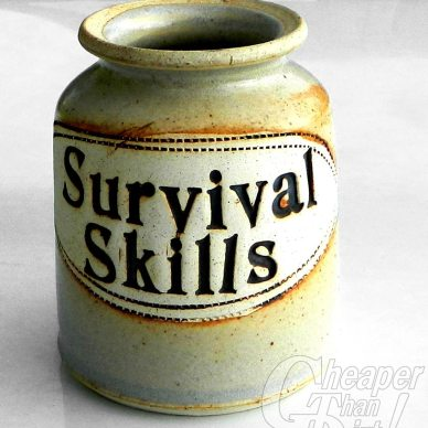 Green clay container with the words Survival Skills on the outside