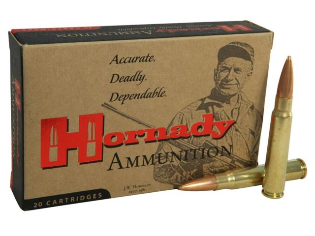 Tan box of Hornaday 8mm cartridges with red and black lettering on a white background