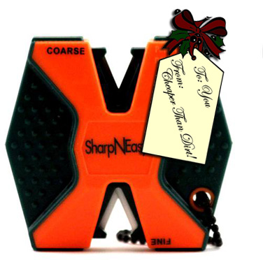 Picture shows a black and orange hexagonal keychain knife sharpener.