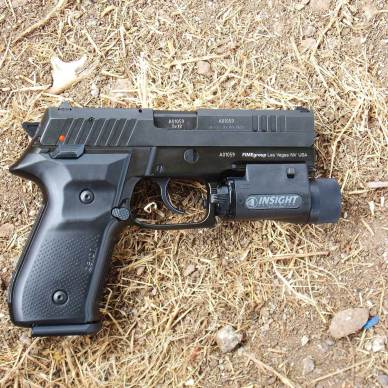 Arex Rex Zero 1 pistol right profile with Insight light mounted to rail