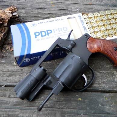 Armscor M206 revolver on a box of Delta Precision ammunition