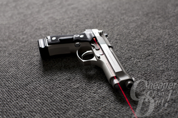 Stainless Beretta 92 with Crimson Trace and 20 round MecGar magazine.
