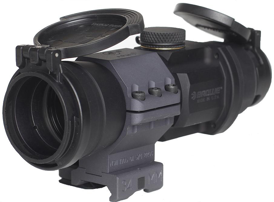 Picture shows a black, compact illuminated dot sight in a mount for AR-15 rifles.