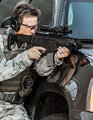 Tactical officer leaning against vehicle and shooting Burris Burris XTR II 1-8x24mm scope