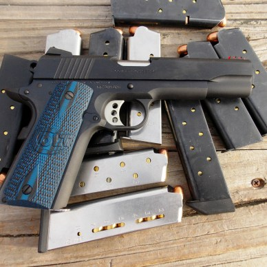 Colt Competition 1911 pistol with assorted loaded magazines