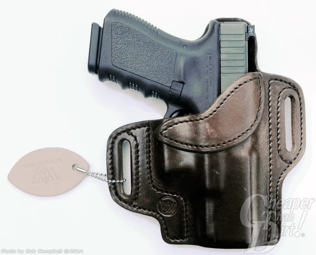 Black handled GLOCK 19 in a dark brown leather Writer Holster on a white background