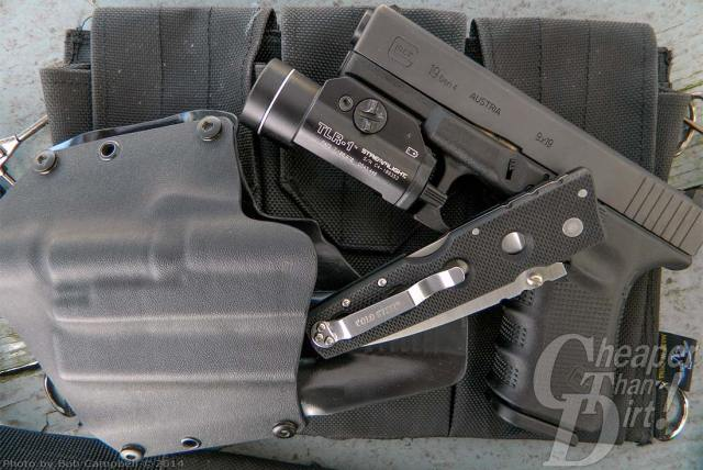 Black GLOCK with Streamlight, cold steel and a black holster.