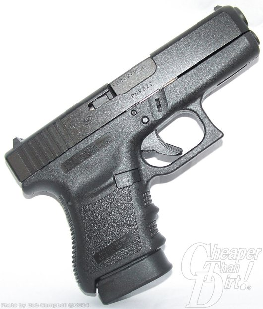 Black GLOCK 36 .45 ACP, barrel pointed up and to the right, on a white background