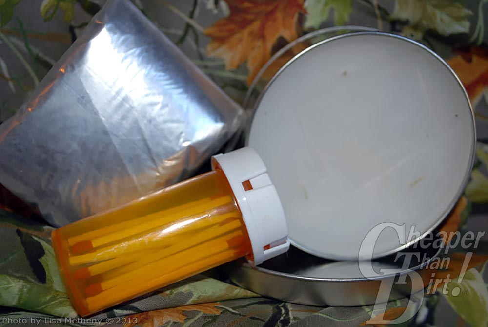 A silver package of sheet plastic, an amber prescription bottle with matches and a silver rimmed signal mirror on a multi-colored floral background.