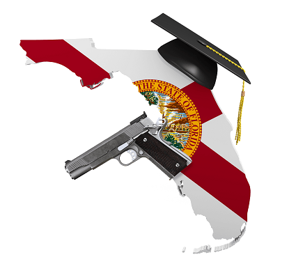 State of Florida with a 1911 handgun and mortar board hat