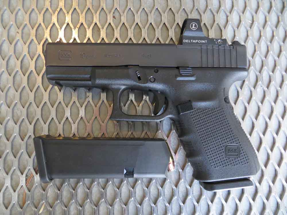 Glock G19 MOS pistol left side with spare magazine