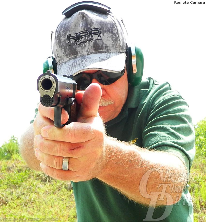 Man in green shirt and camo hat shoots Remington R1 Commander with HPR Ammo