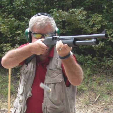 Bob Campbell shooting a pump shotgun