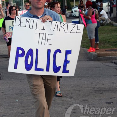 Protestor holding a Demilitarize the Police in Ferguson Missouri