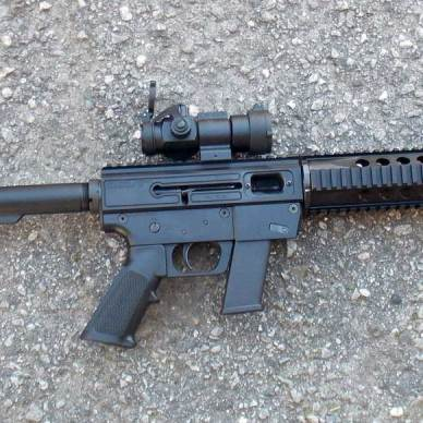 JRC rifle with scope right profile