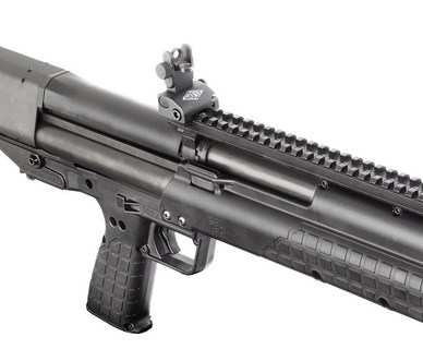Black Kel-Tec KSG Pump gun, barrel pointed toward you on a white background.